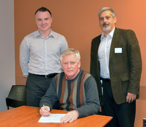 Jim Stirling, HIEA board chair signs the contract with Matt Lawson (left), Manager, Health Hazards Program Hamilton Public Health Services and Anthony Ciccone (right)  Ph.D., P. Eng of Golder Associates.